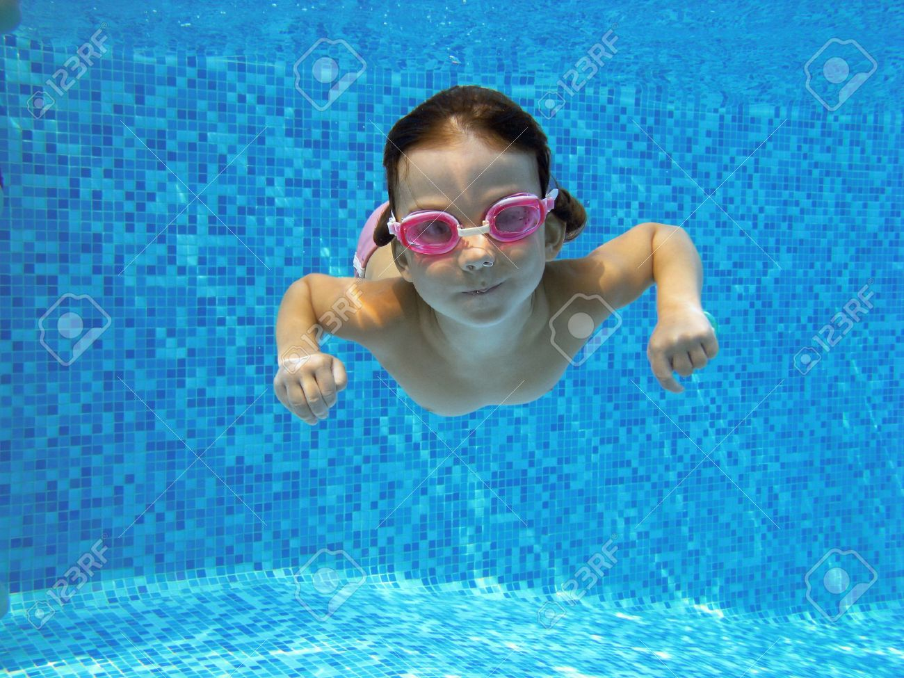 Kid Swimming Underwater In The Pool Stock Photo Picture And