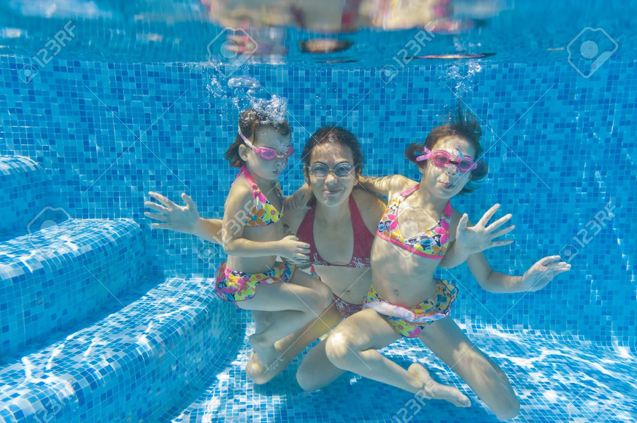 Nudist children Stock Photo - Underwater family in swimming pool