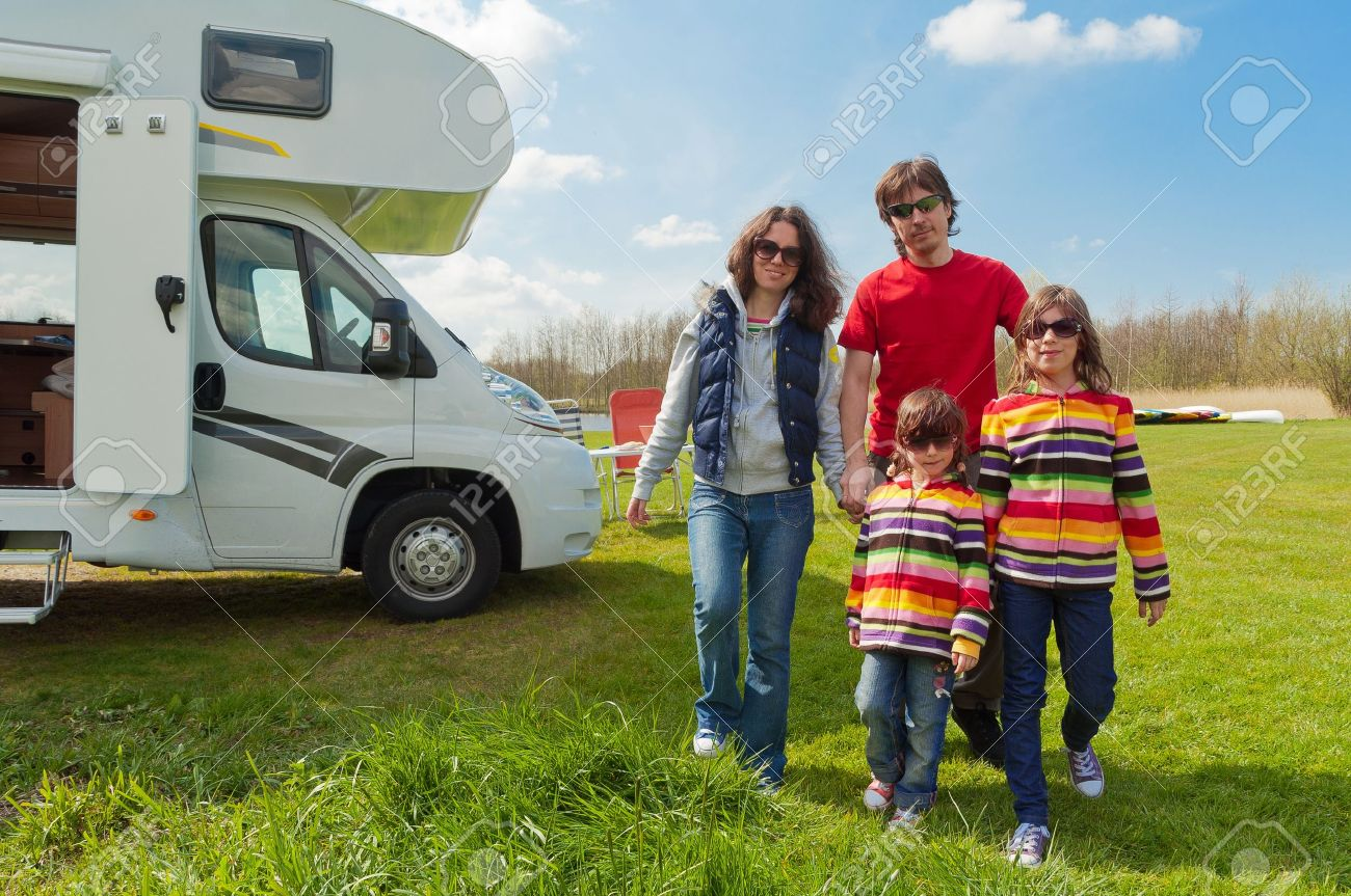 Family Vacation In Camping Happy Active Parents With Kids Travel On Camper Having Fun Near Their Motorhome Spring Trip Children