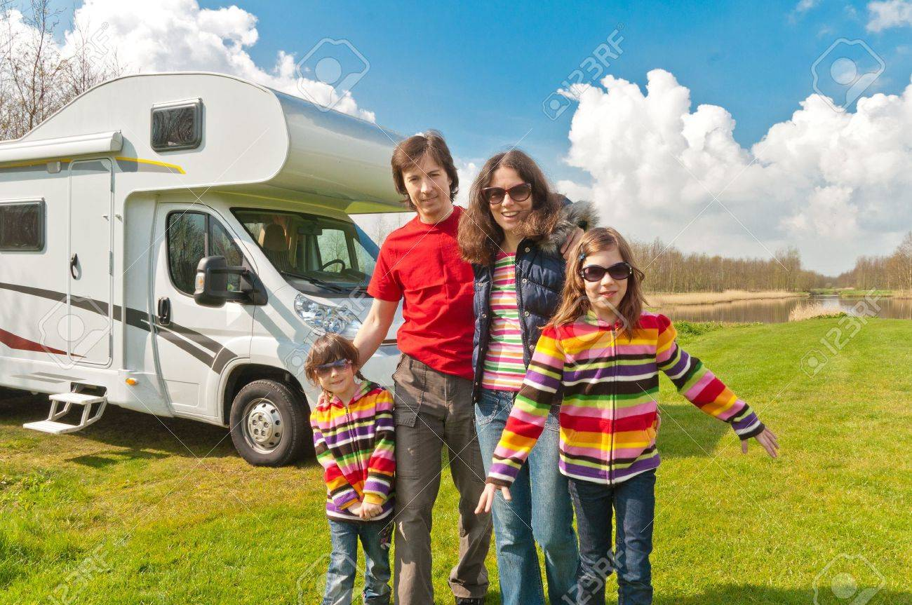 Family Vacation In Camping Happy Active Parents With Kids Travel On Camper RV Having Fun