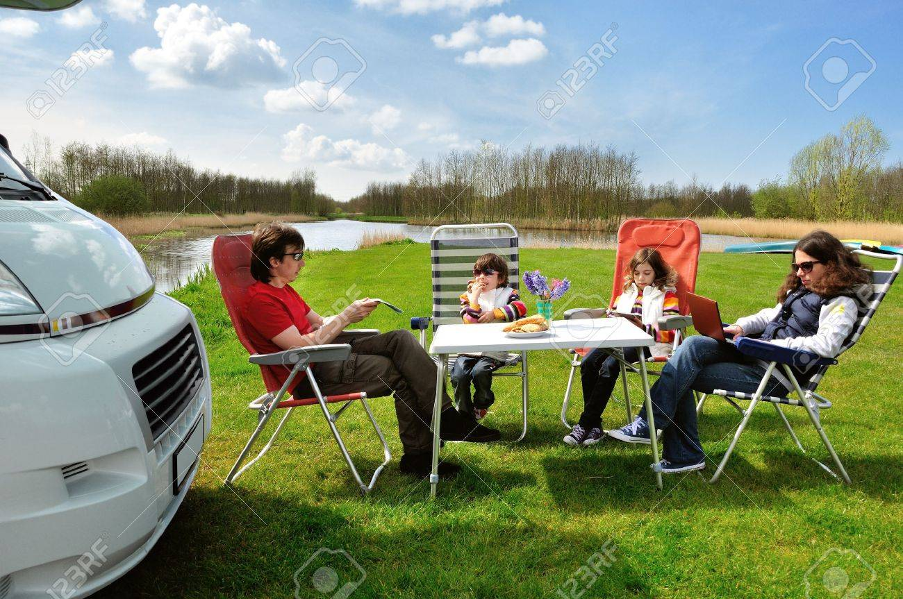 Family vacation in camping  Happy active parents with kids travel on camper  RV   Family having fun  and relaxing near their motorhome  Spring holiday trip with children Stock Photo - 14349787