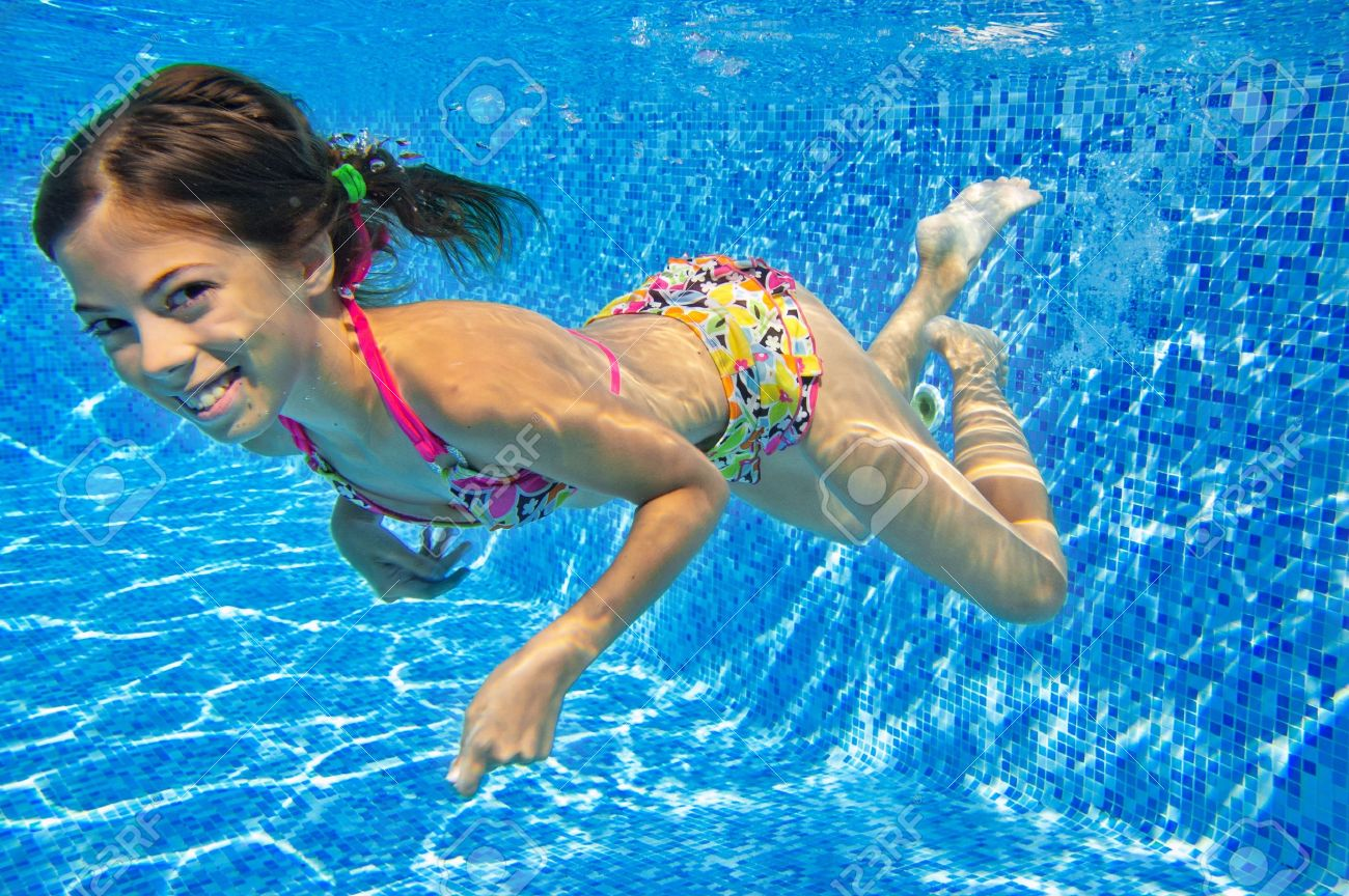 Happy Smiling Underwater Child In Swimming Pool Beautiful Girl