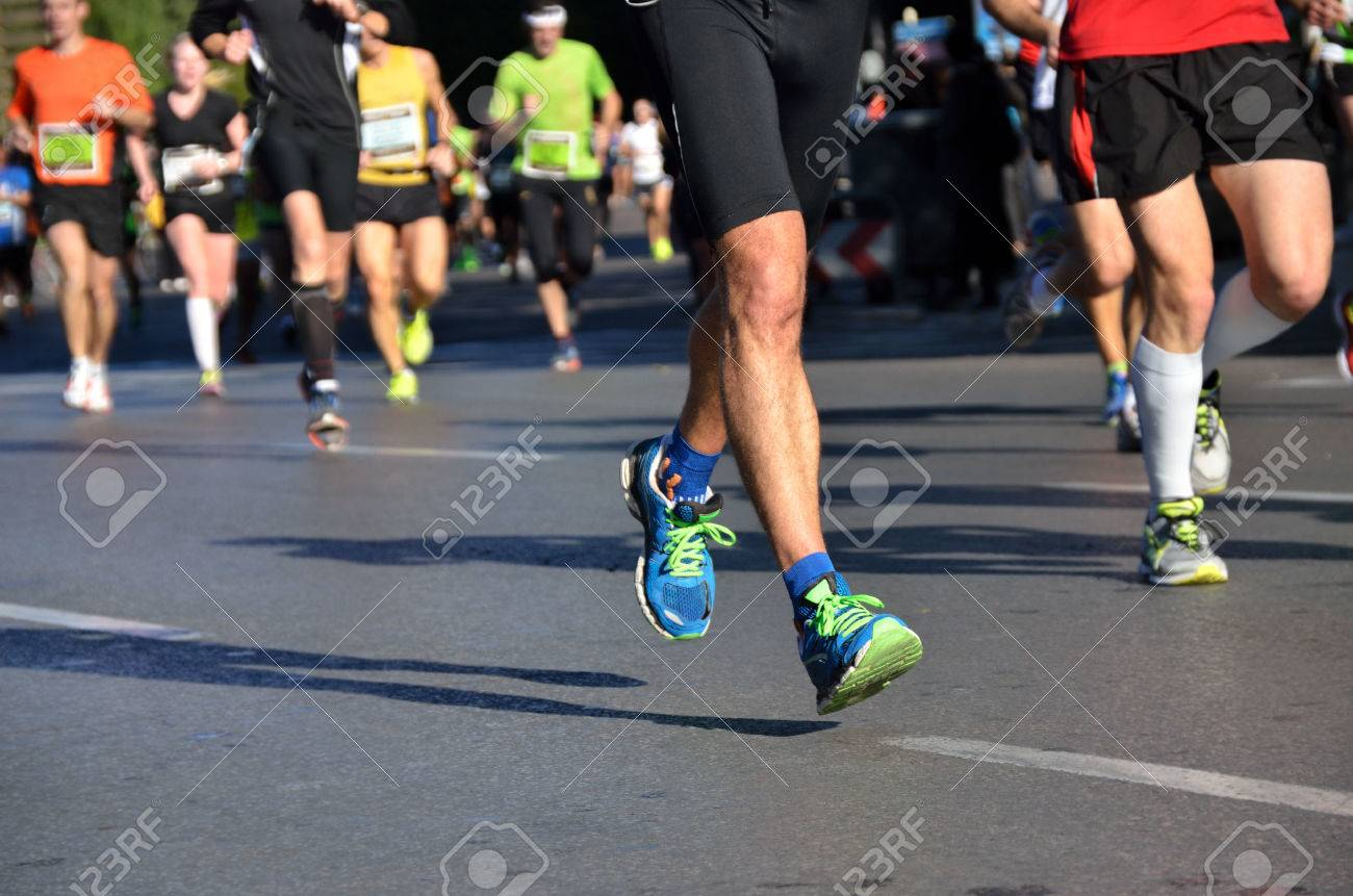 Marathon running race, people feet on road, sport, fitness and healthy lifestyle concept - 24263879