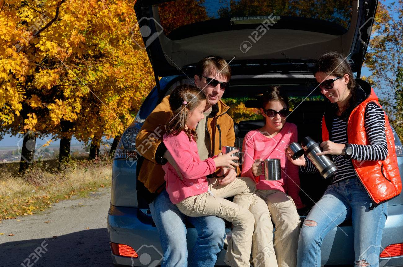Car trip on autumn family vacation, happy parents and kids travel and have fun, car insurance concept - 32644717
