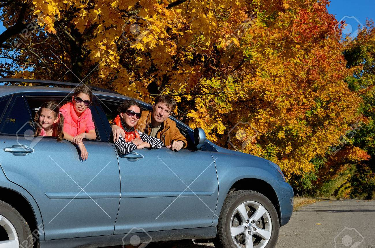 Car trip on autumn family vacation, happy parents and kids travel and have fun, car insurance concept - 32644727