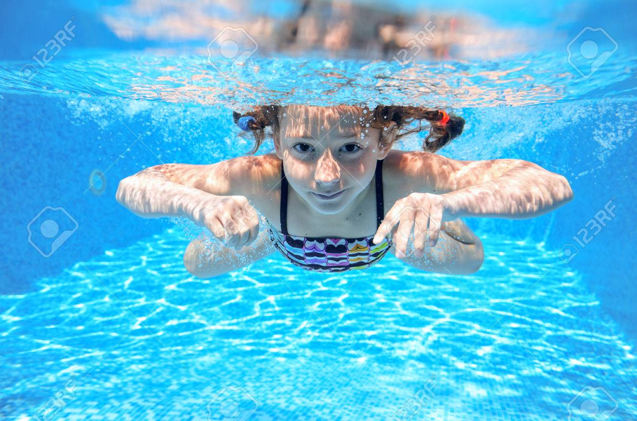 Happy girl swims in pool underwater, active kid swimming, playing and having fun, children water sport - 38788477