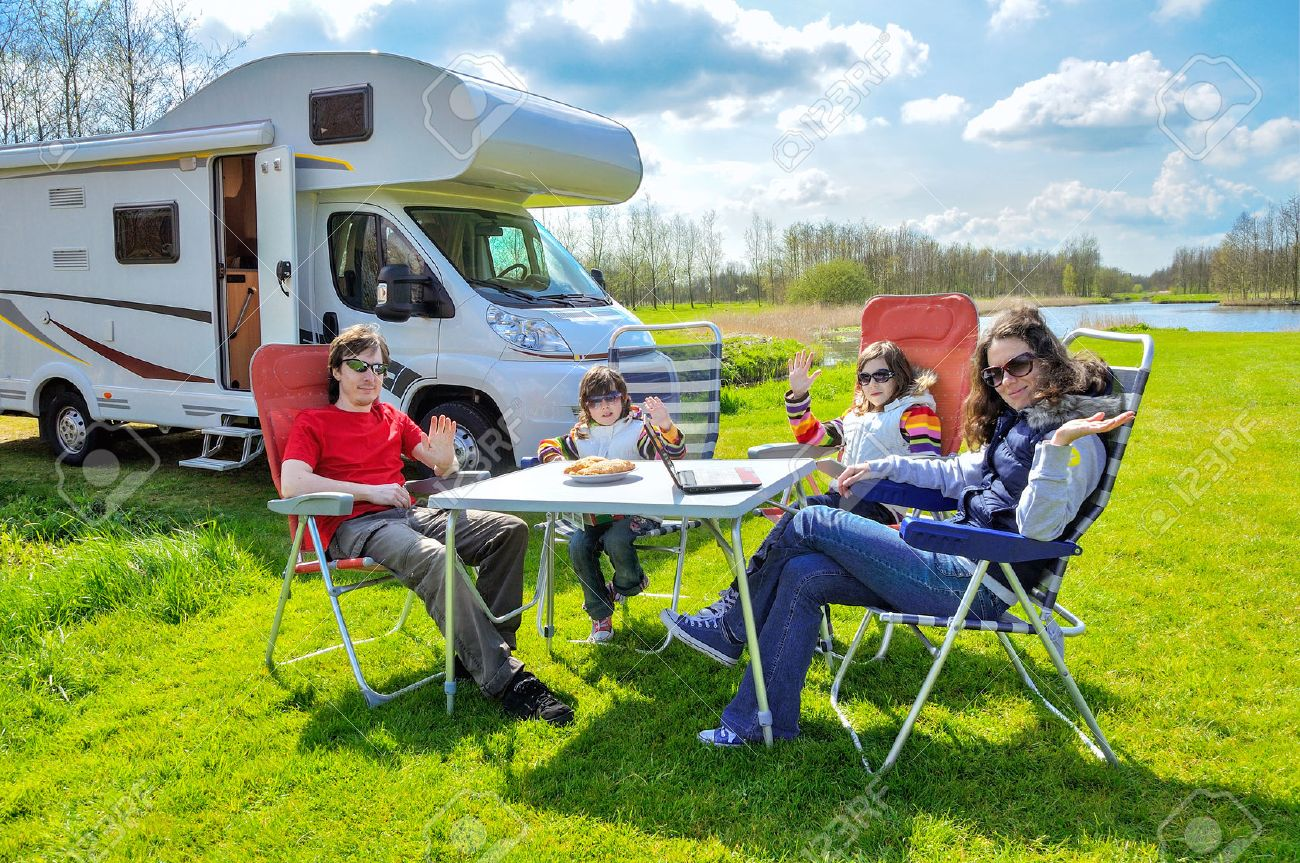 Family vacation RV camper travel with kids happy parents with children on holiday trip in motorhome - 39487456