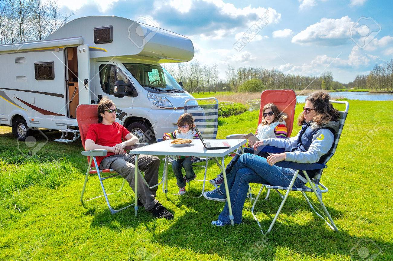 Family vacation RV camper travel with kids happy parents with children on holiday trip in motorhome - 39487457