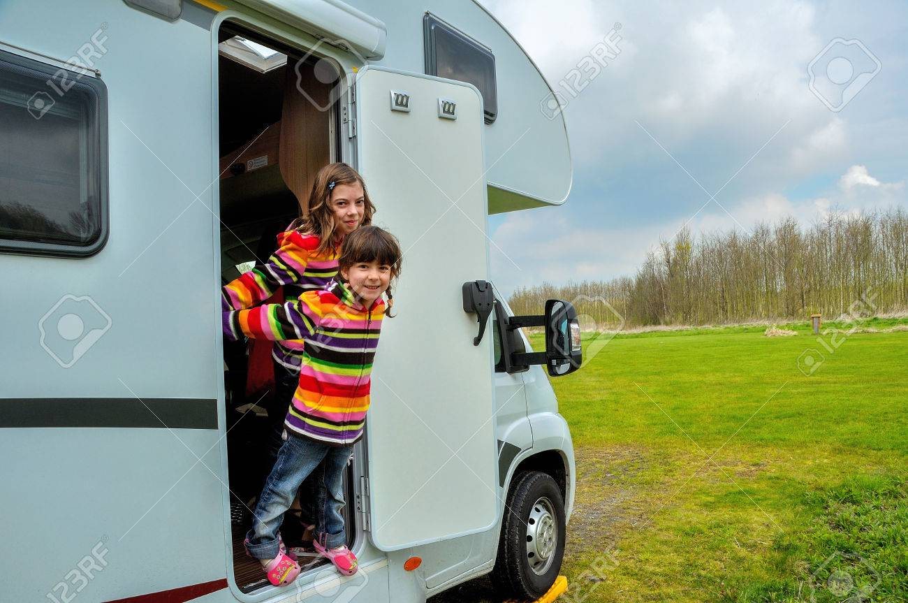 Kids in camper rv family travel in motorhome on vacation - 39487458