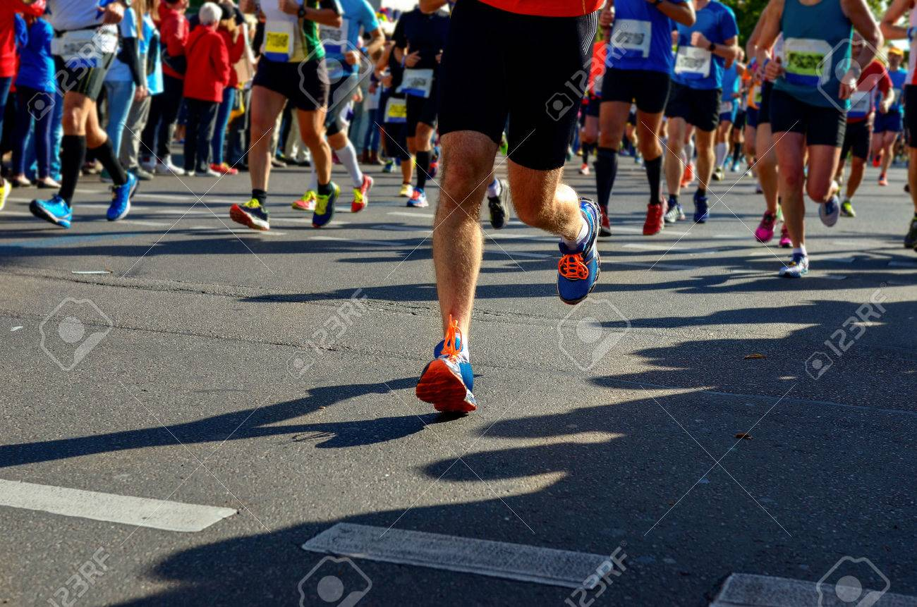 Marathon running race, runners feet on road, sport, fitness and healthy lifestyle concept - 50775959