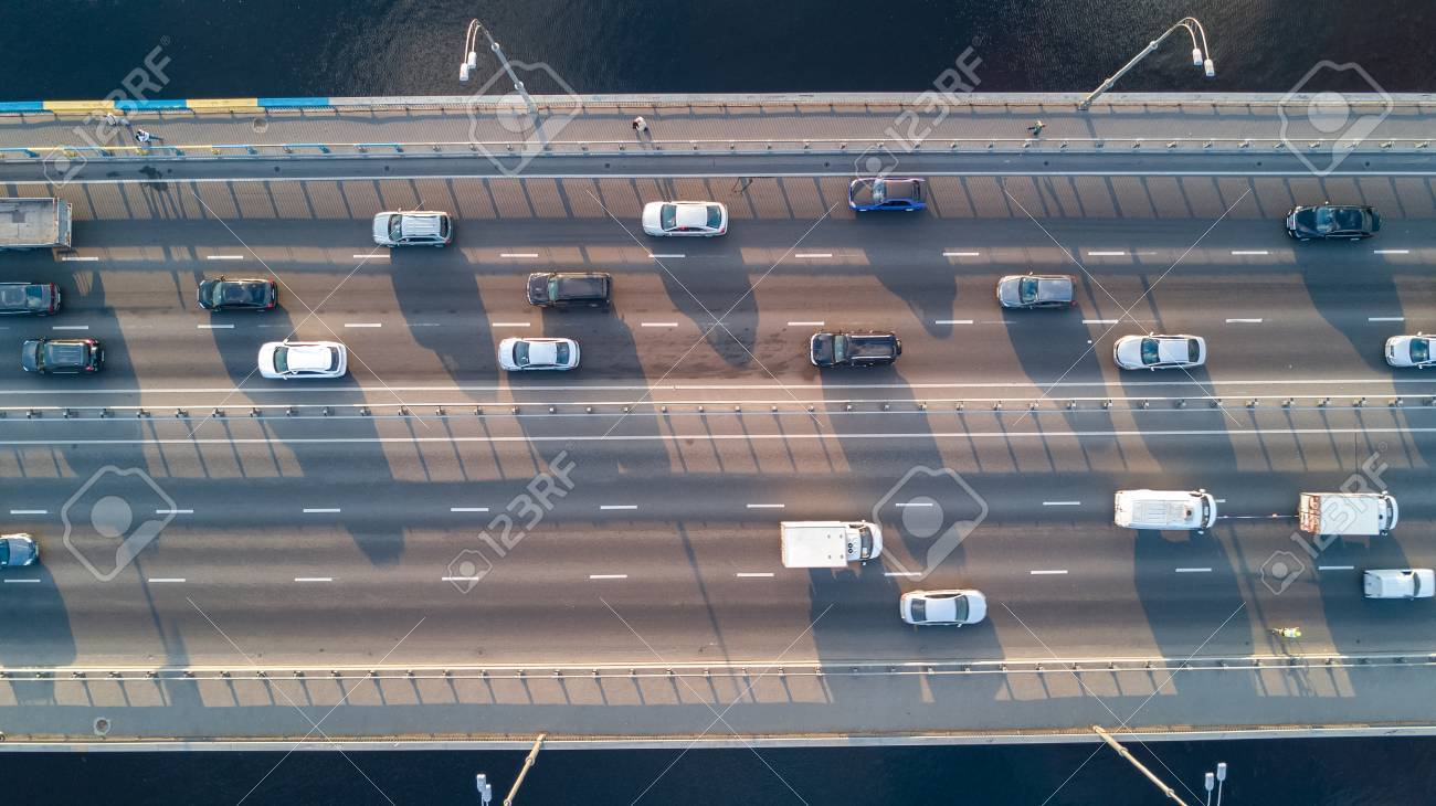 Aerial top view of bridge road automobile traffic of many cars, transportation concept - 83649054