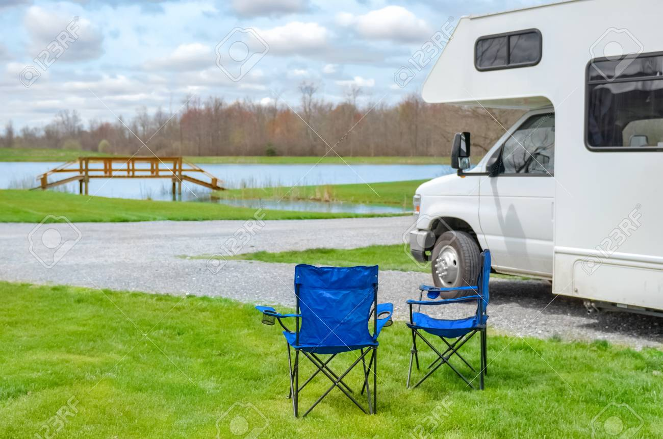 Admirable Rv Camper And Chairs In Camping Family Vacation Travel Holiday Beatyapartments Chair Design Images Beatyapartmentscom