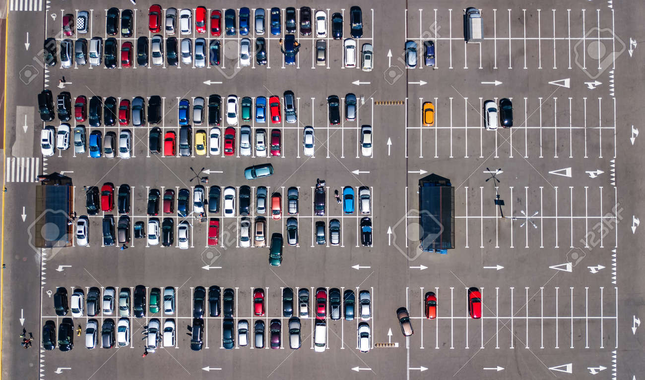 Aerial drone view of parking lot with many cars from above, city transportation and urban concept - 155651981