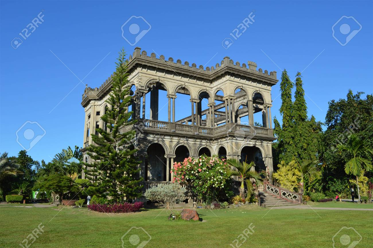 Two Story Old Big House With Plants Around Stock Photo Picture And