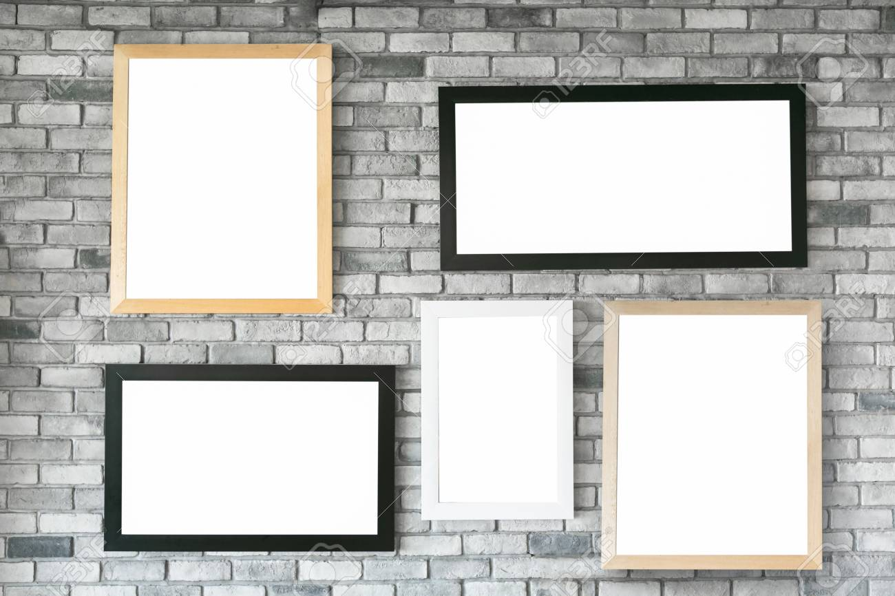 8317158c22b Different size and style empty photo frames on white concrete wall. with  clipping path Stock