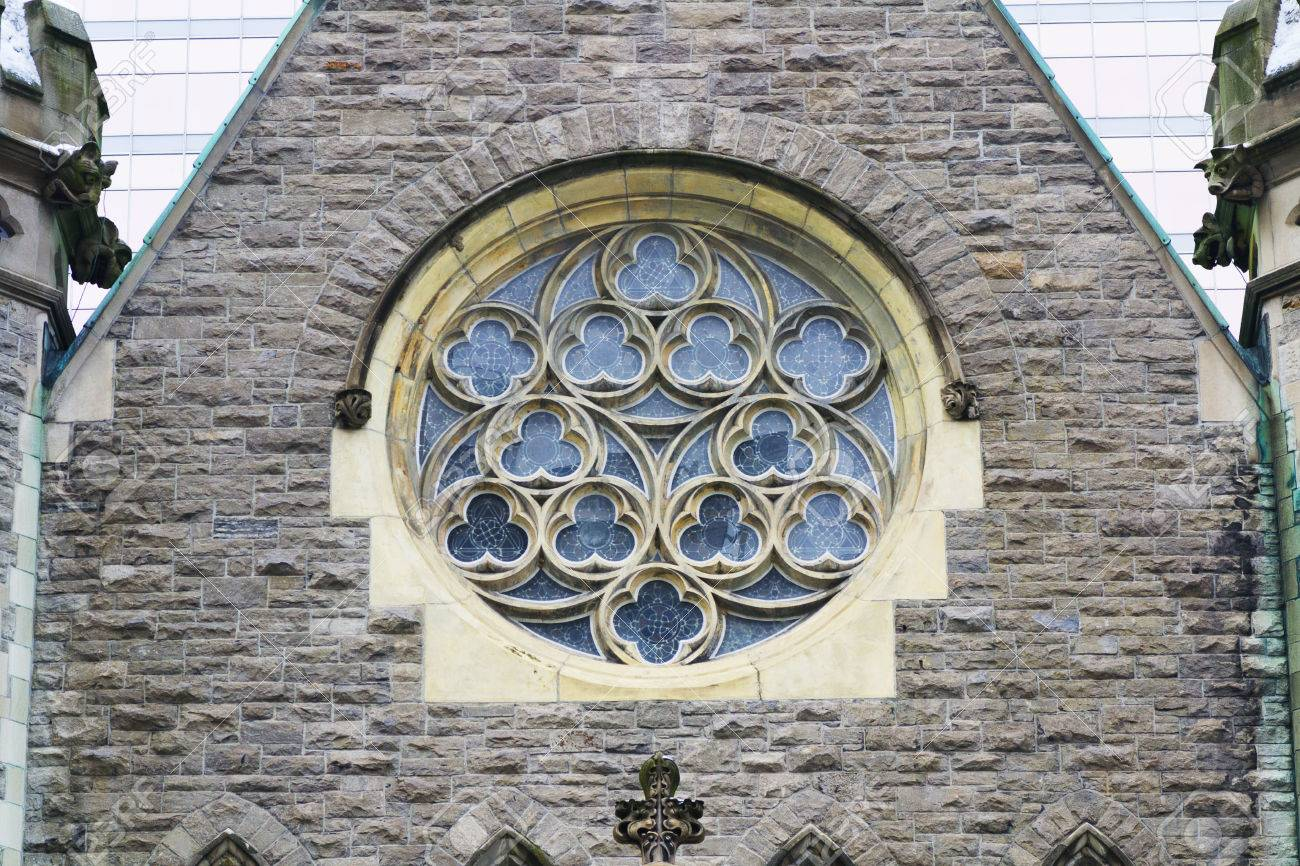 Gothic Church Round Window On Front Stone Wall Stock Photo