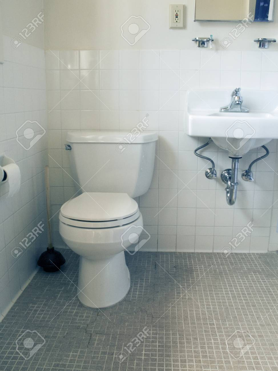 Small Bathroom With White Old White Tiles With Toilet And Sink Stock ...