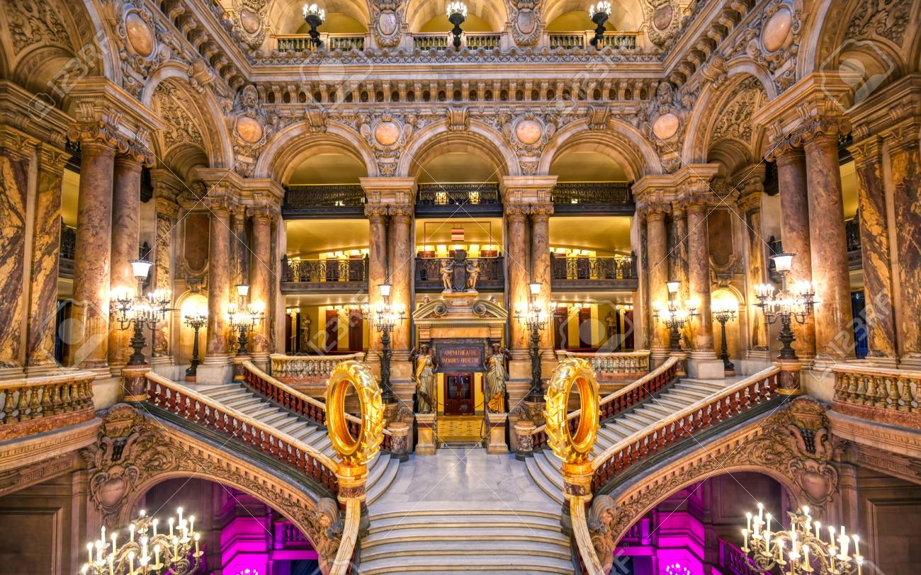 Paris, France - April 23, 2019 - The Grand Staircase at the entry to the Palais Garnier located in Paris, France. - 128623641