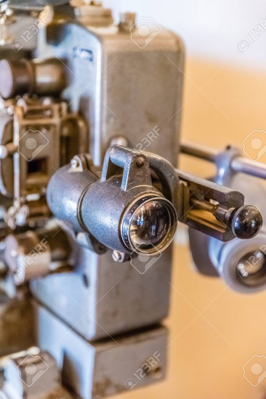 Old movie projector for cinema. Vintage movie camera keep in museum. It is use with retro film. But the body is classic design. The vintage cinema projector is analog and difficult to use it. - 147319076