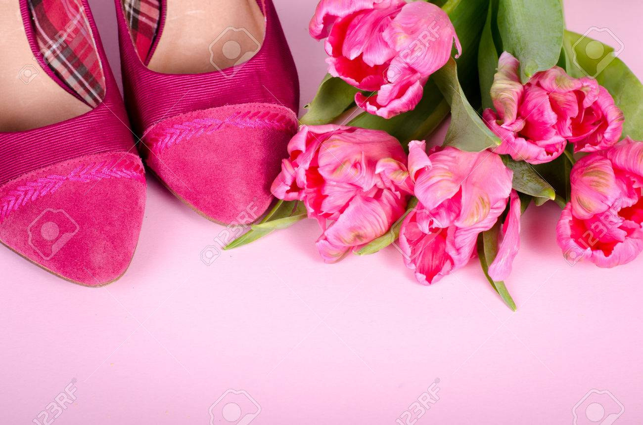 Ladies pink high heel shoe and tulips woman background with stock ladies pink high heel shoe and tulips woman background with copy space concept symbol biocorpaavc Gallery