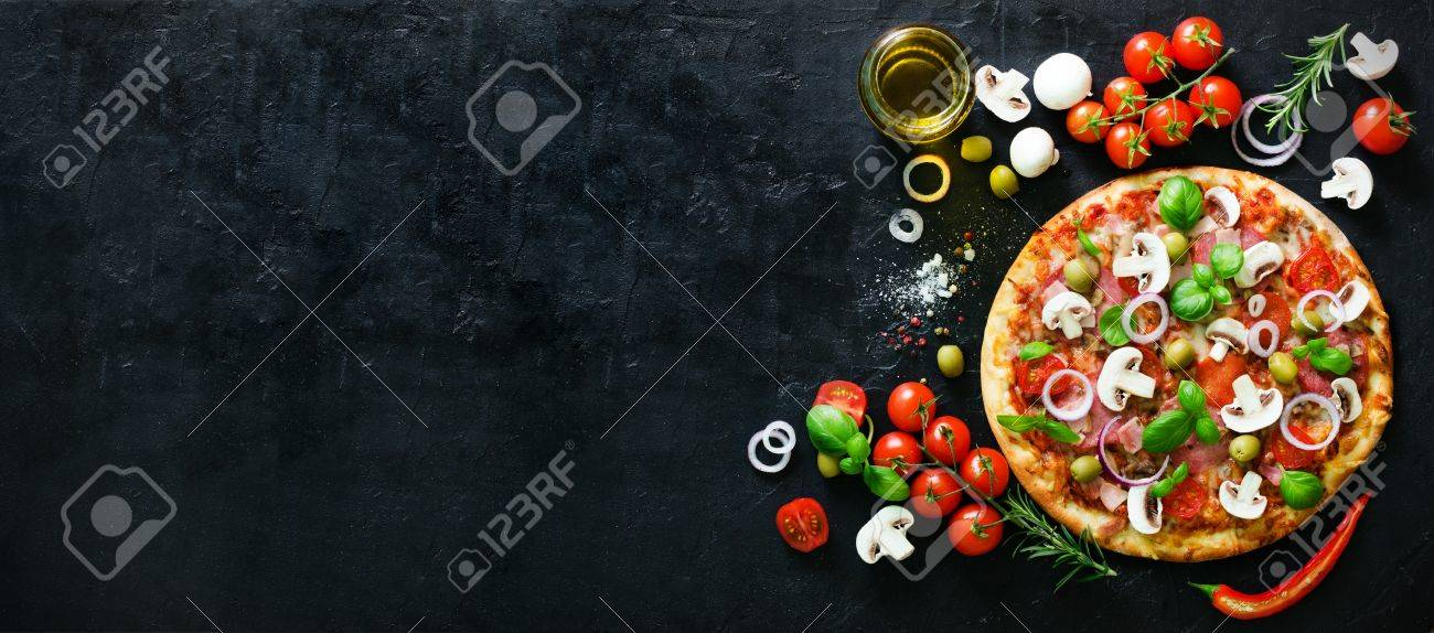 Food ingredients and spices for cooking mushrooms, tomatoes, cheese, onion, oil, pepper, salt, basil, olive and delicious italian pizza on black concrete background. Copyspace. Top view. Banner - 73234974