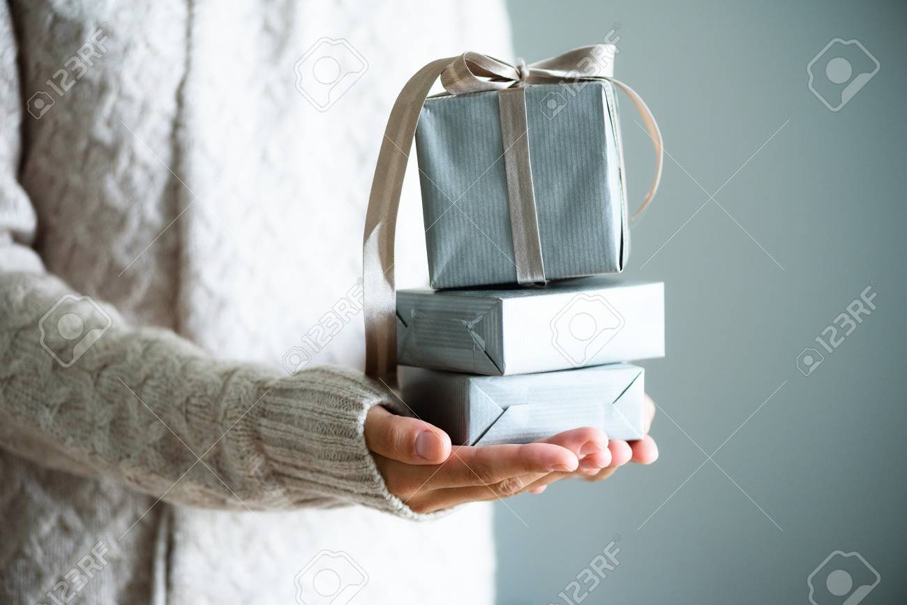 Female hands holding gift box. Copy space. Christmas, hew year, birthday concept - 89086587