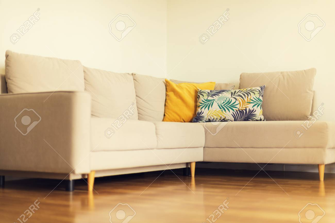 Pleasant Modern Beige Sofa Yellow And Blue Pillows With Tropical Palms Bralicious Painted Fabric Chair Ideas Braliciousco