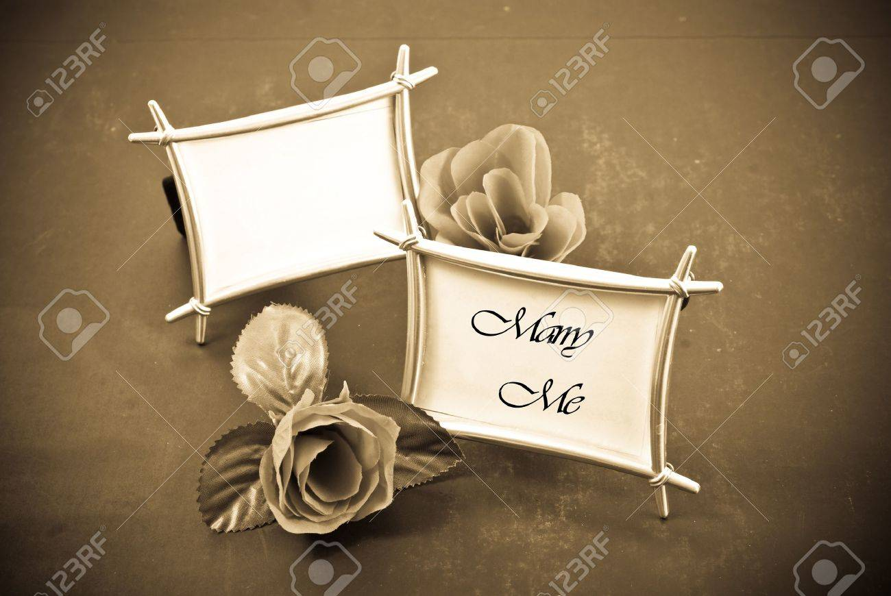 c34e35758b Two Frames And Roses With One Frame Saying Marry Me Stock Photo ...