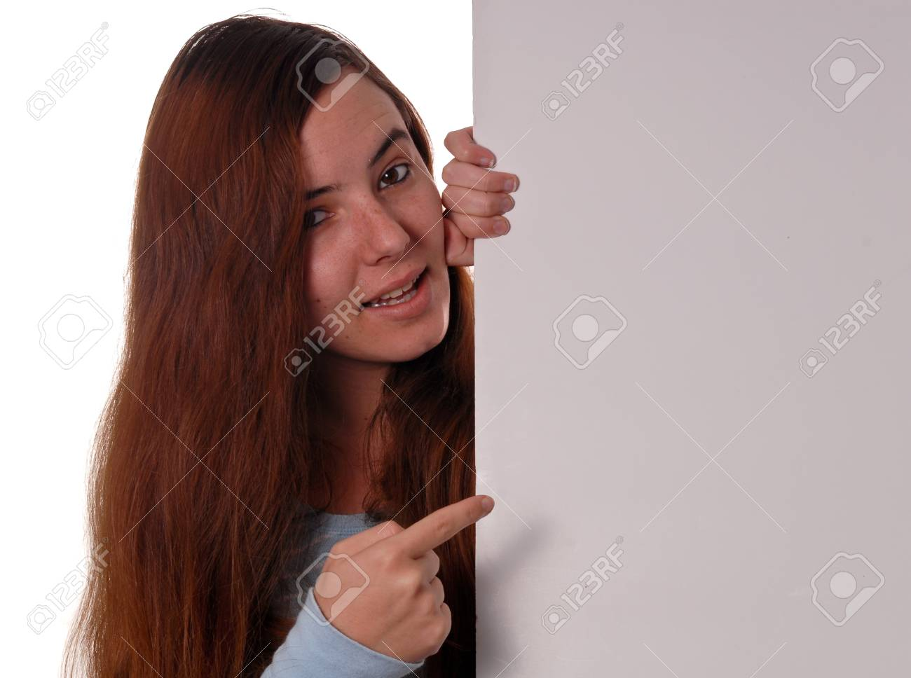 Girl Pointing at Blank Poster (Custom Space for Text) Stock Photo - 9198311