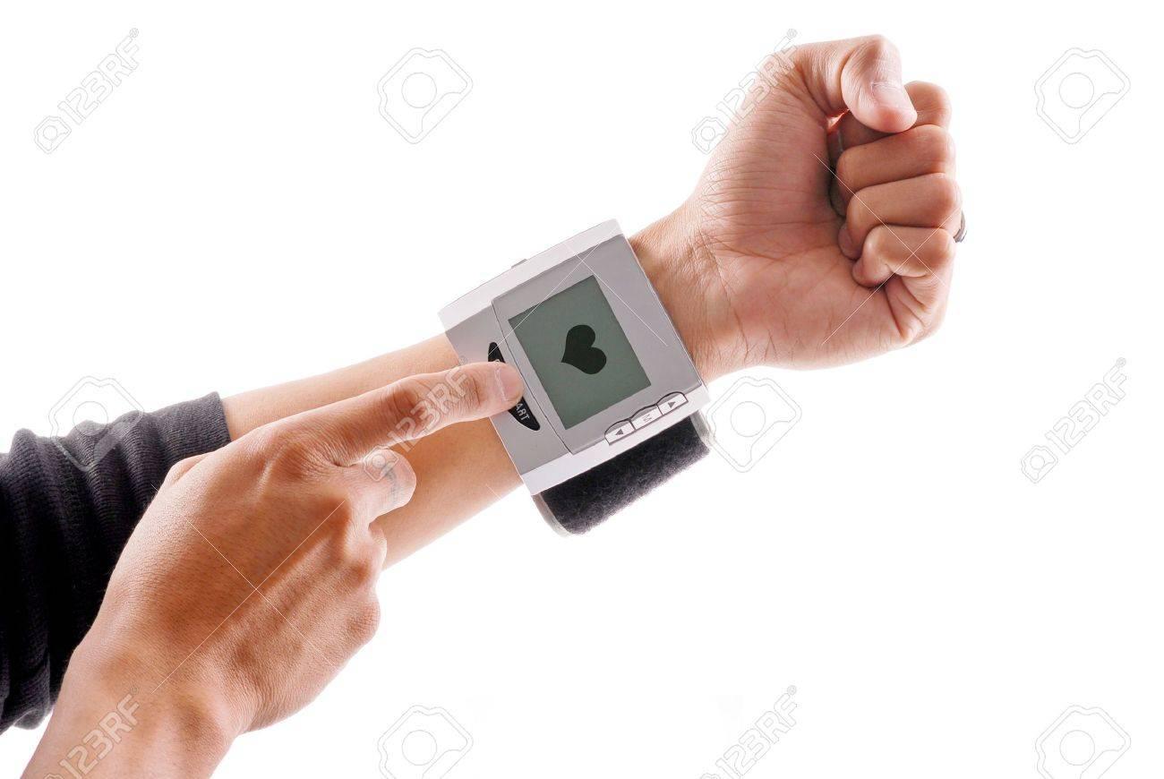 Using a Blood Pressure Wrist Monitor Stock Photo - 9373451