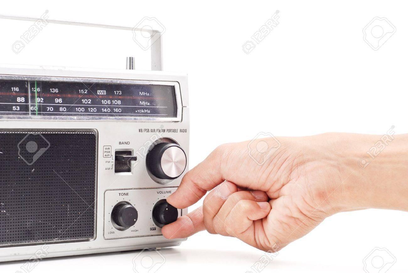 Hand Turning Up the Volume on Vintage AM FM Radio Stock Photo - 9672750