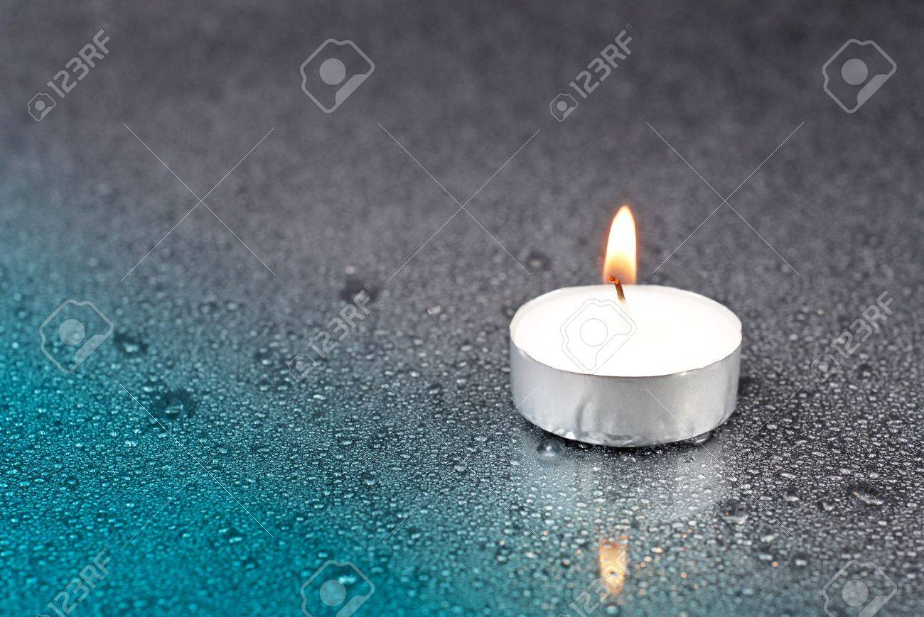 Candle In The Rain Stock Photo...