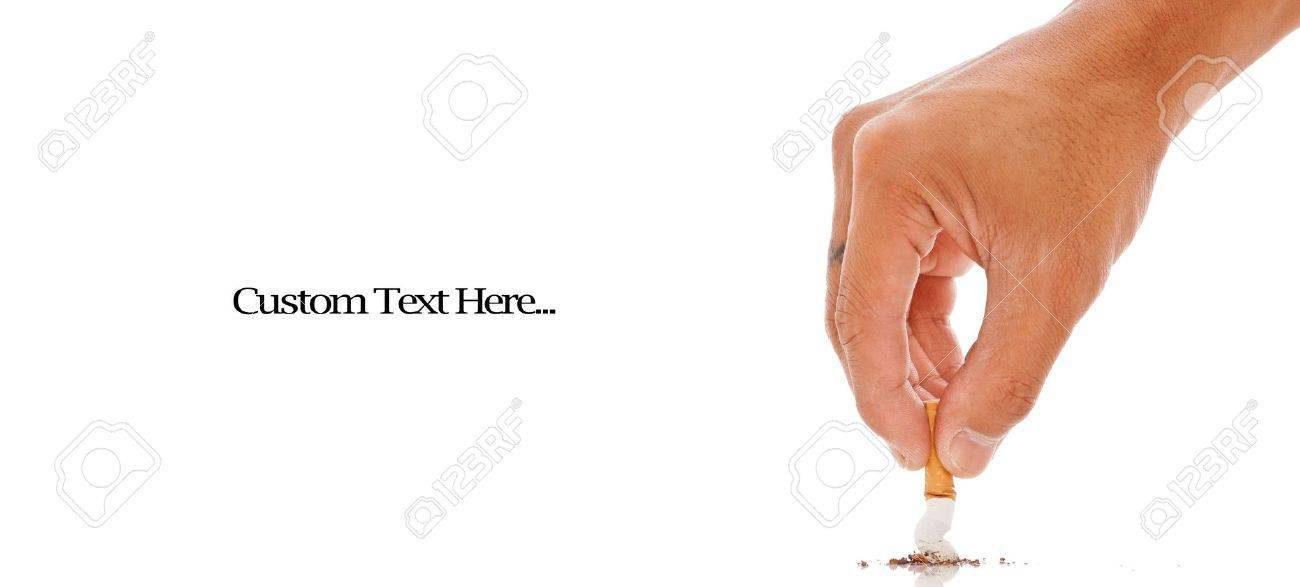 Hand Putting Out a Cigarette Stock Photo - 9991156