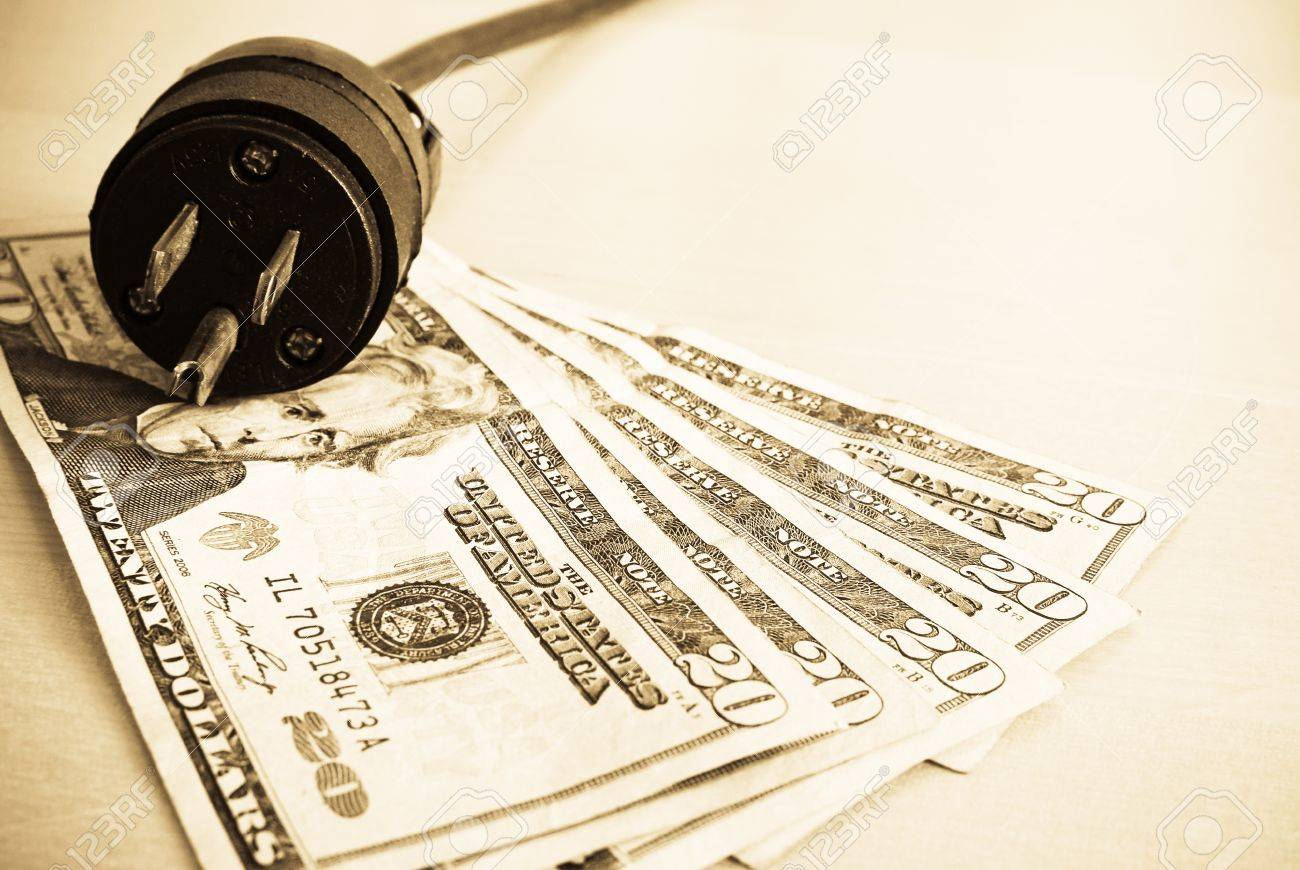 Unplugged Outlet Plug on Money Stock Photo - 9991250
