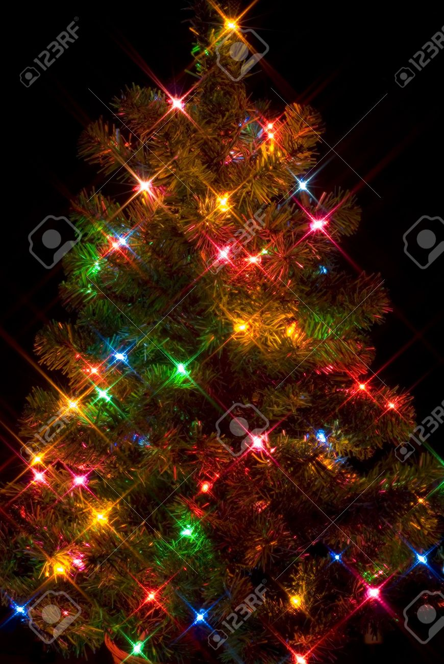 Christmas Tree On Black Background With Starburst Lighting Effect ...