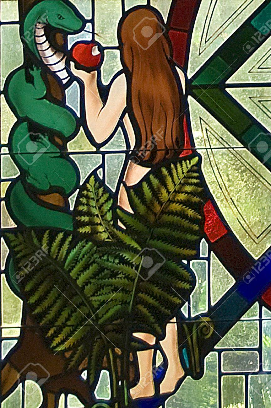 Eve tempted by the serpent by eating the forbidden fruit stained glass window segment Stock Photo - 8305882