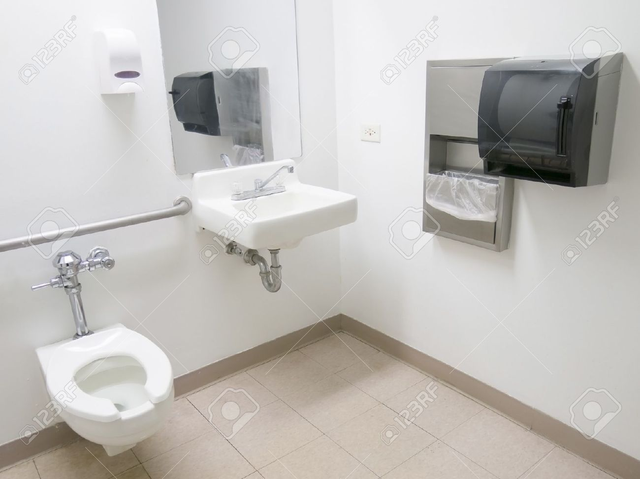 Disabled Toilet Clean Public Hospital Bathroom With Handrail Soap And Paper Towel Dispenser