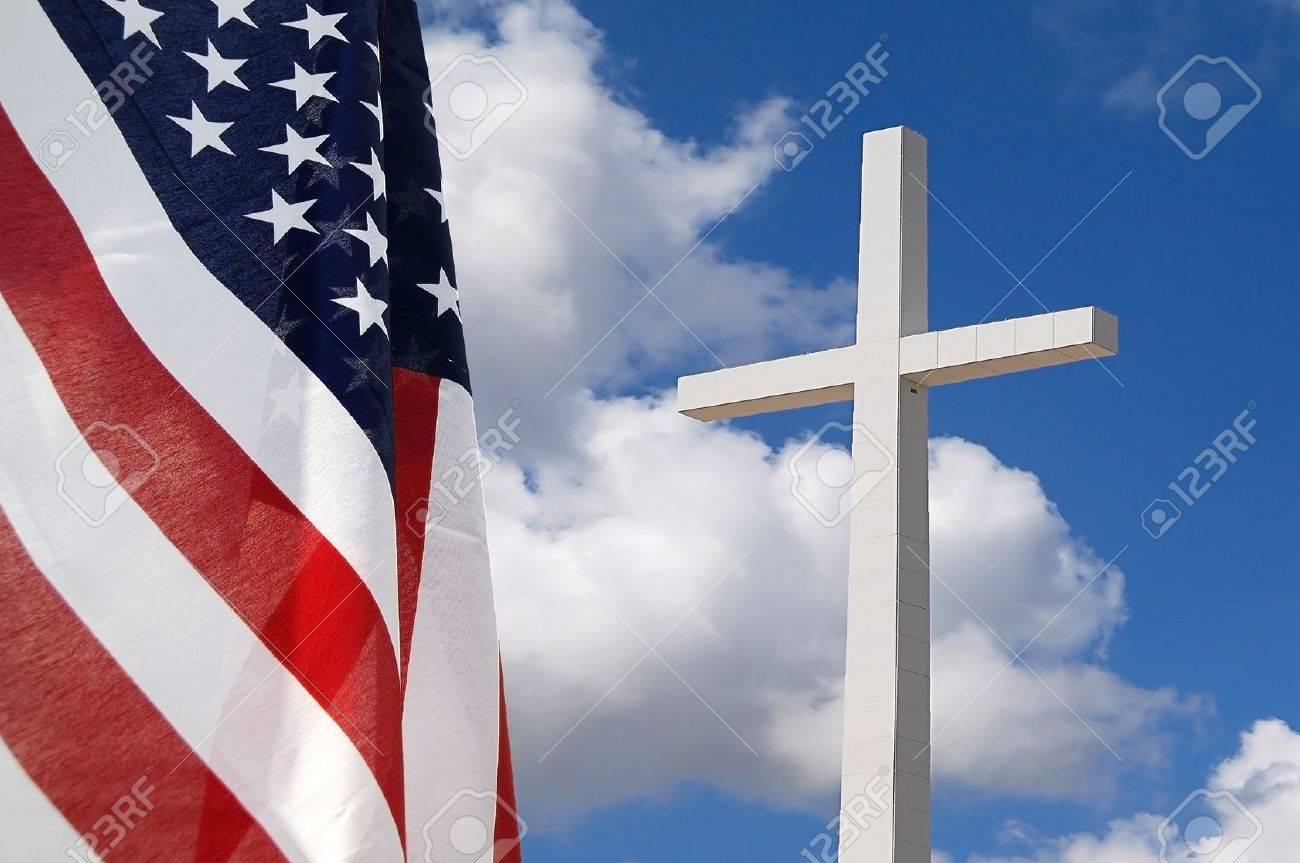 Silhouette of the holy cross on background of storm clouds stock - Clouds Cross United States Flag With Cross Indicating God And Country
