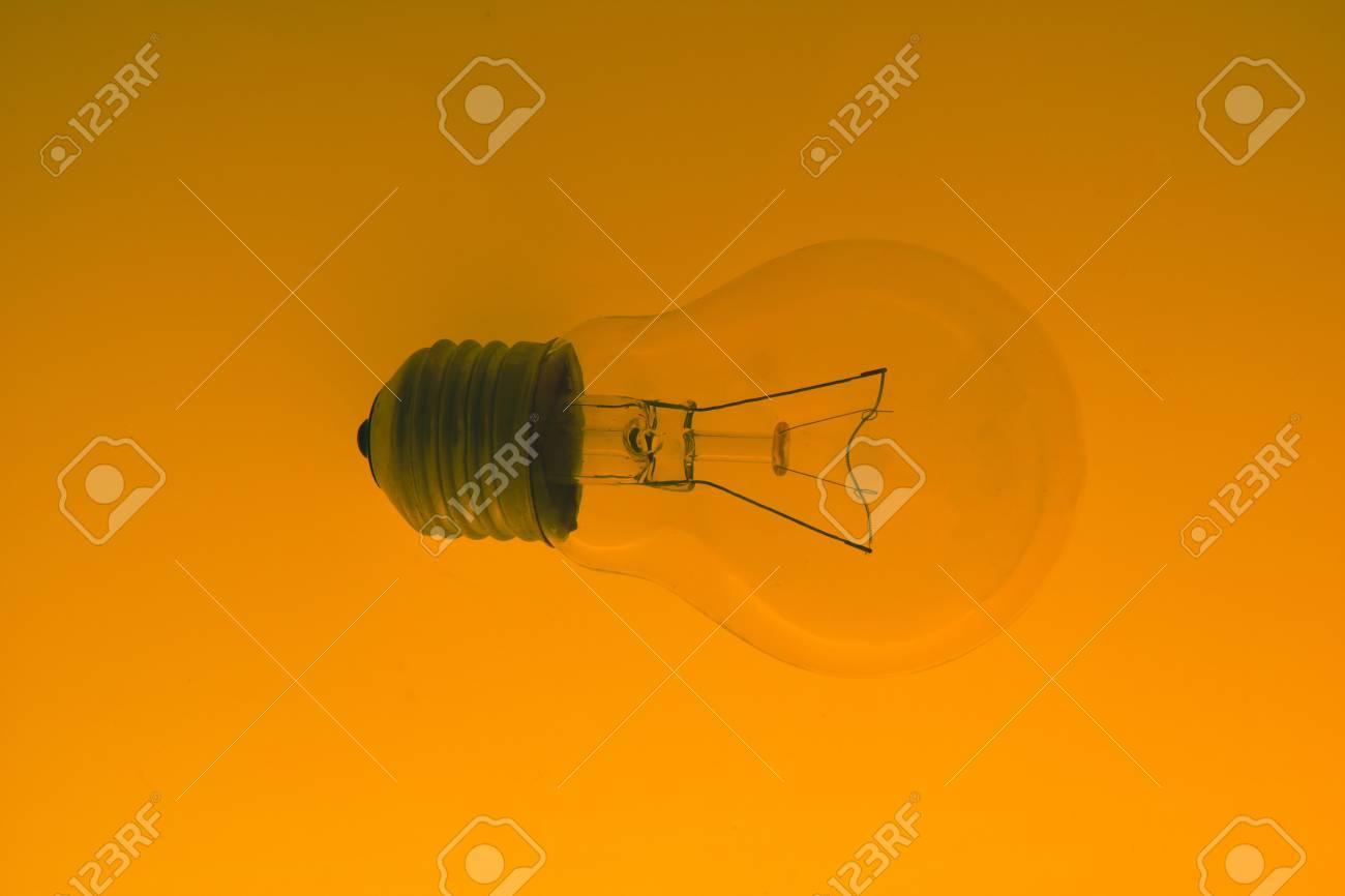 light bulb on gradient  orange  background Stock Photo - 12084617