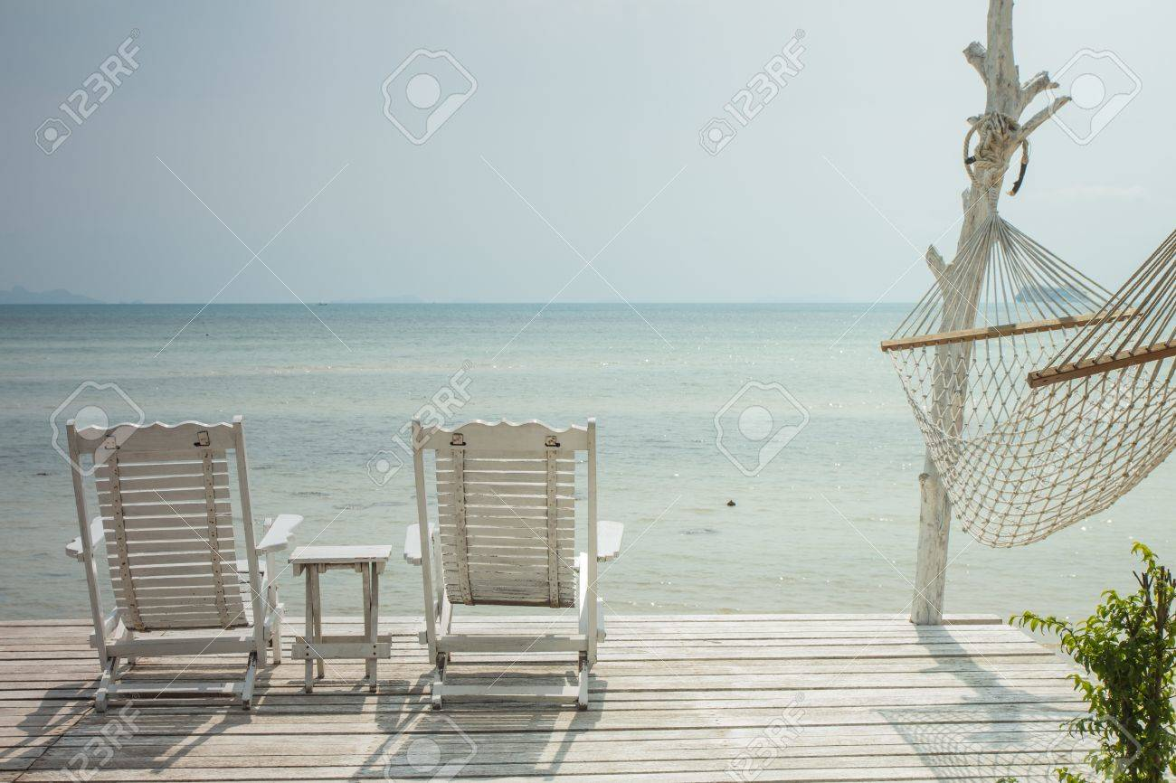 Stock Photo   White Beach Chair And Hammock At Resort,Thailand