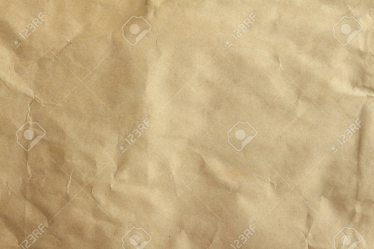 Crumpled brown paper texured background Stock Photo - 24642247