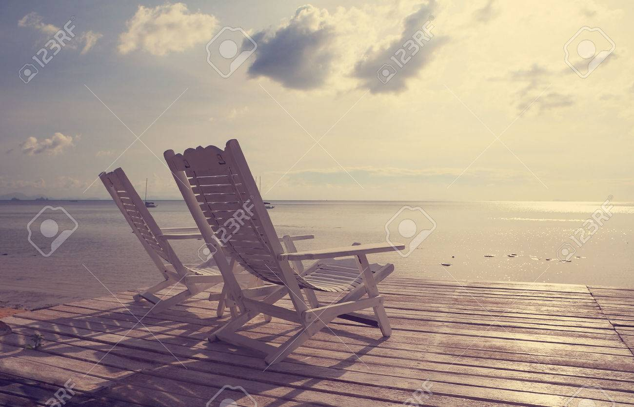 White Wooden Beach Chair Facing Seascape Vintage Filter Effect Stock Photo Picture And Royalty Free Image Image 27493766