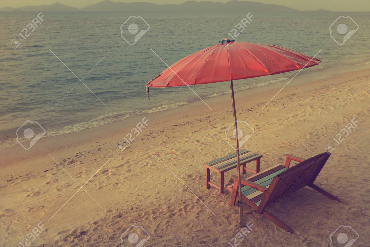Retro Wooden Beach Chair With Red Umbrella Stock Photo Picture And Royalty Free Image Image 32085846