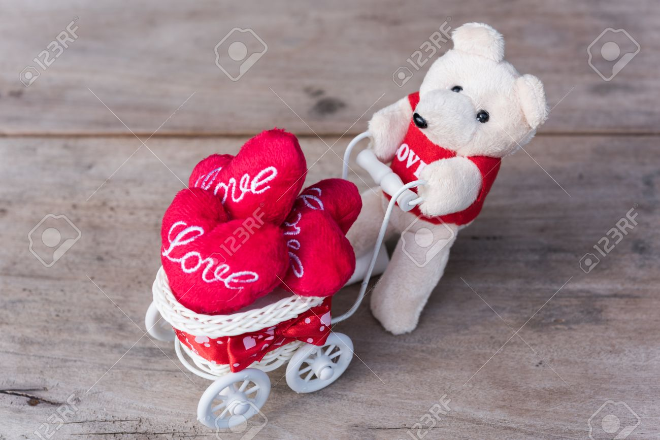 Cute teddy bear carry love heart items with white bicycle on cute teddy bear carry love heart items with white bicycle on grunge wood background stock photo voltagebd Image collections