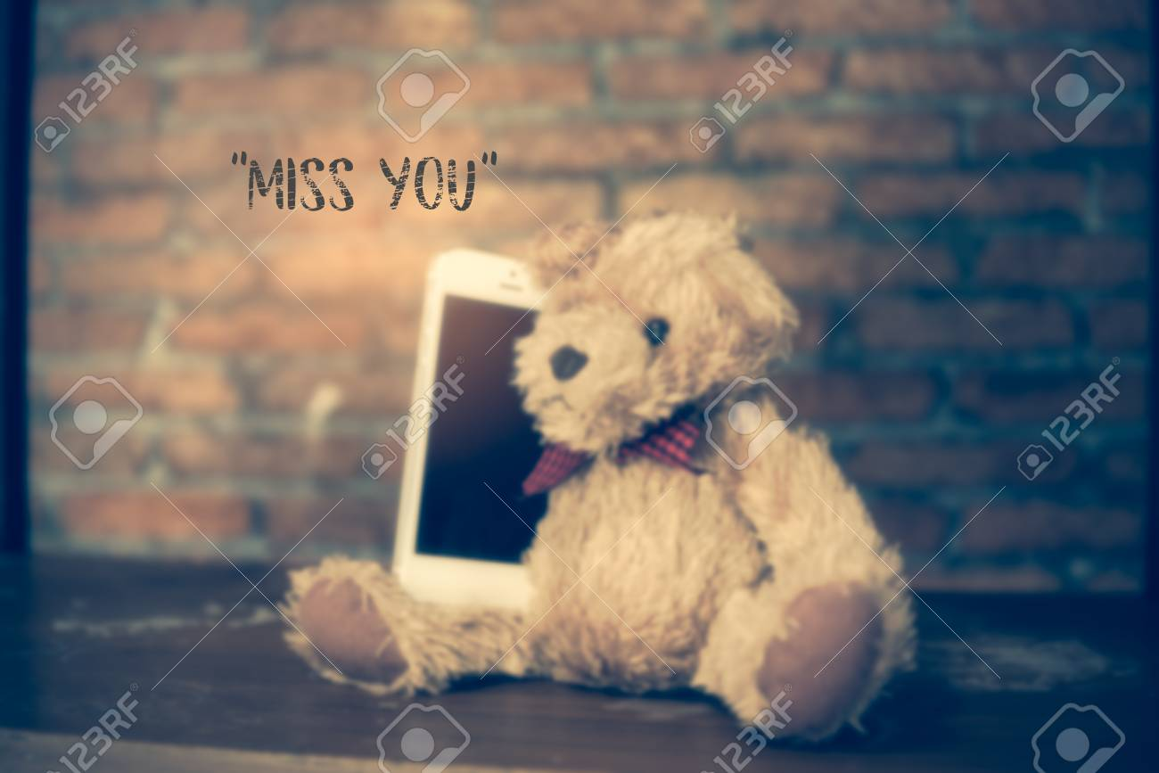 miss you text with blurred teddy bear background stock photo