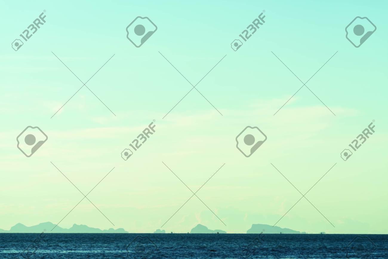 Seascape bright blue sea skay white clouds background - 115300639