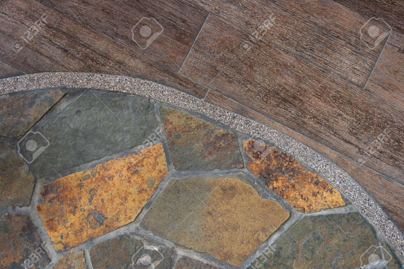 The border between flagstone and old wood flooring create an