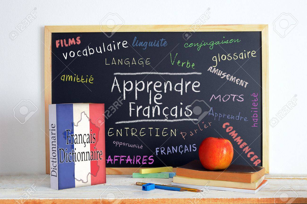 Blackboard with the message LEARN FRENCH and some text - 57610587