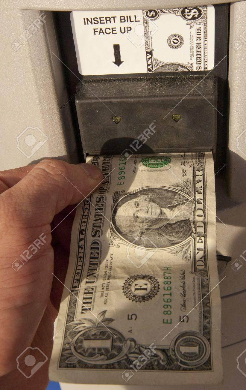 Feeding A Dollar Bill Into A Vending Machine Stock P O 19145424