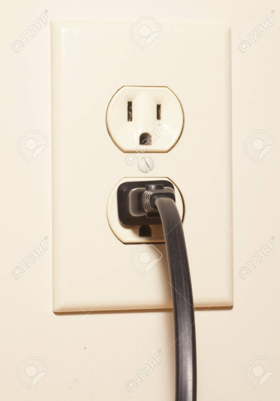 A plug connected to an electrical outlet Stock Photo - 20493049